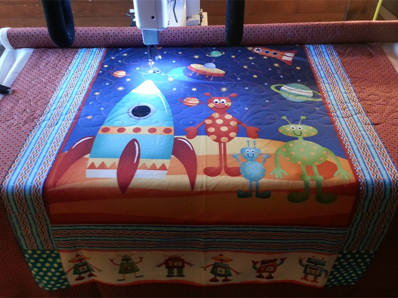 Alien quilt, a gift for Baby Henry. Pieced by Bonnie and quilted by Katie (The Kid)