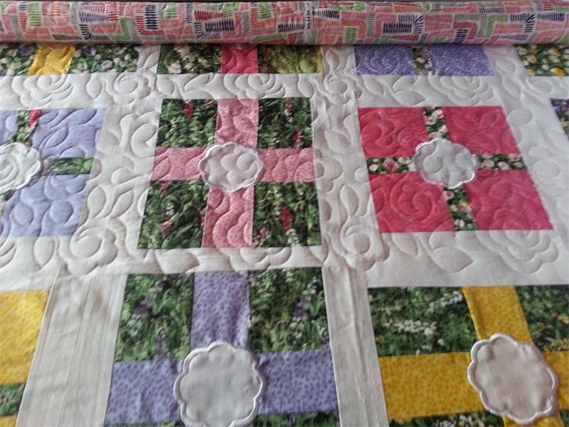 Flower blocks with embroidery. Pieced by Crystal (The Crazy Old Goat) and quilted by Katie (The Kid)
