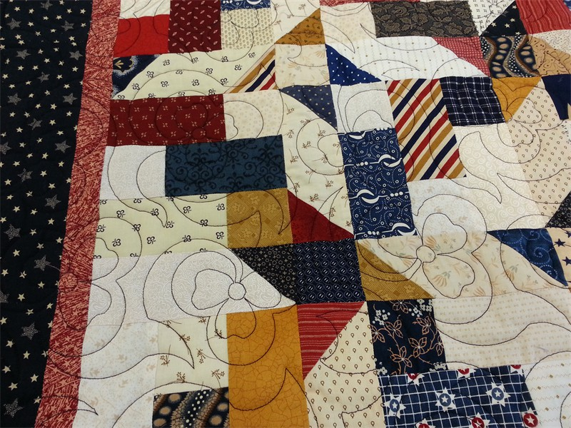 Scrappy Quilt of Valor pieced by Patty, Clover stitching and quilted by Katie (The Kid)